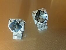 Silver cufflinks with simulated blue diamond