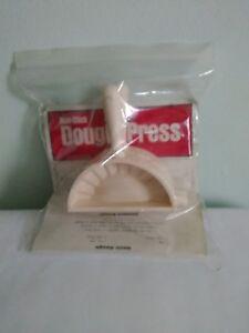 Dough press, non-stick