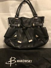 B Makowsky leather handbag with storage bag. Excellent preowned condition.