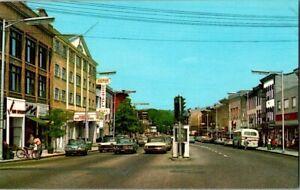 Main Street Danbury Connecticut street view old classic cars, bus, shops hotel