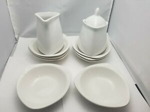 Oneida Casual Settings set 8  saurce plate  sugar bowl with cover and creamer