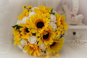 WEDDING FLOWERS BRIDES WITH SUNFLOWERS ALSO BRIDESMAIDS & BUTTONHOLES AVAILABLE.