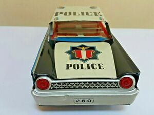 VINTAGE POLICE TIN TOY CAR 250 HIGHWAY PATROL FRICTION POWERED METAL RUBBER WORK