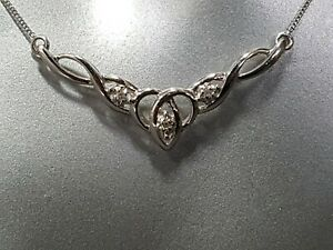 9ct White Gold & Diamond Celtic Necklace. Ref xIod.