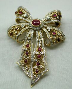 Stunning 18 carat Gold Ruby And Diamond Bow Shaped Brooch