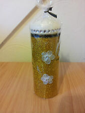 Decorative Christmas candle with gold glitter and flowers