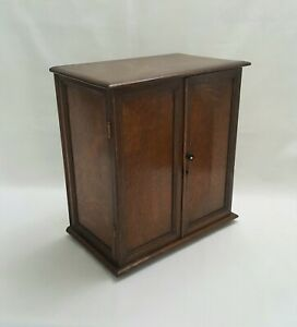 Vintage solid oak smoker's cabinet with interesting provenance ex Enfield Palace