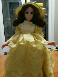 Heritage Mint collectable doll in yellow dress and hat