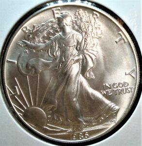 1986 Silver American Eagle Dollar in Large Holder