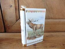 bouteille à liqueur Limoges en forme de livre décor les plaisirs de la chasse