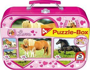 Schmidt horses, 4 jigsaw puzzles in a tin suitcase. 2 x 48 piece, 2 x 26 piece.