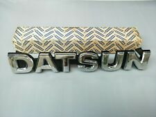 NEW DATSUN 720 PICKUP Front Grille BADGE/EMBLEM. Size 5x32cm