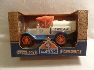 NEW IN BOX ERTL COLLECTIONS ELMER'S GLUE DIE CAST METAL BANK ORANGE BLUE. WHITE.