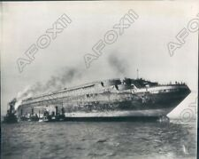 1944 Ocean Liner Normandie Towed To Shipyard After Fire In New York Press Photo