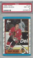 1989 Topps hockey card #112 Doug Wilson, Chicago Blackhawks graded PSA 8 NMMT