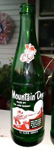 Mt. Dew, 12oz acl soda bottle. Filled by Hal and Sammy. 1965