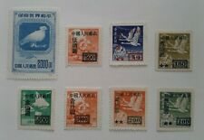 7 China Overprint Stamps Circa 1950: Flying Geese, Locomotive, Airplane + More