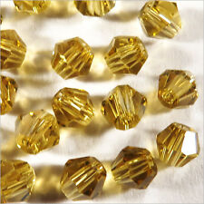 40 Perlas Tupis de vidrio 4mm Amarillo Topacio