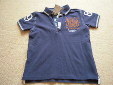 New With Tags Navy Polo  Top by Next in Size 5 to 6 Years. (Height 116cm)