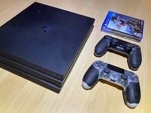 Sony PlayStation 4 Pro 1TB 4K Console *USED* + 2 Games & 2 Controllers - Black