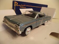 AMERICAN MINT WELLY PREMIUM CHEVROLET IMPALA  1964 1/24TH SCALE IN BOX.