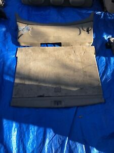 2000-2004 subaru outback trunk lining. Plastic push clips included