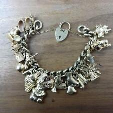 9ct Yellow Gold Charm Bracelet With 30 Charms Attached 117g