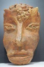 Masque décoratif en terre cuite, représentant un faune