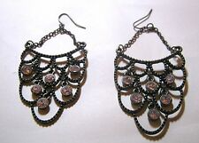 Wonderful bronze tone metal earrings dangle style with white stone decorations