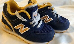 New balance 574 infant boy sz 4 navy blue and yellow athletic lace up shoes
