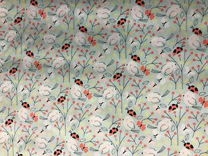 Pale blue ladybird/bird/butterfly design cotton poplin fabric