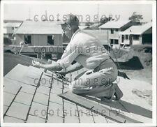 Roofer at Work Press Photo