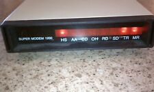 Vintage External 300/1200 Baud Telecommunications Super Modem.