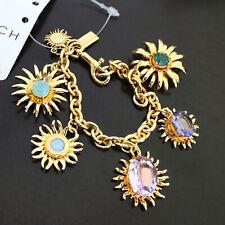 NWT COACH 95930 Tony Duquette Sunburst Flower Gold Pave Mix Charms Bracelet NEW