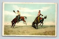 """COWBOYS WITH HATS IN COWBOY DRESS """"BRONCHO BUSTING"""" JUST A NICE POSTCARD A2"""