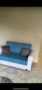 Brand new cotton and leather Baby blue and white futon storage couch. Artistic