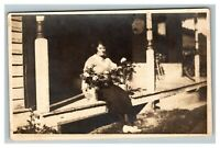 Vintage 1900's RPPC Postcard Woman with Roses Sitting on Porch