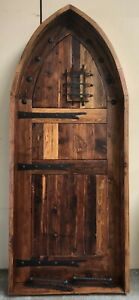 Rustic reclaimed lumber arched top door solid wood TUDOR wine cellar castle iron