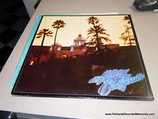 EAGLES HOTEL CALIFORNIA ORIGINAL LP W POSTER, LYRICS, INNER SLEEVE LIKE NEW 1976