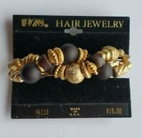 1928 black and gold beaded twist barrette on original card