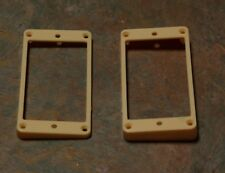 Guitar Humbucker Replacement Mounting Ring Set - New - Dark-Creme, with screws.