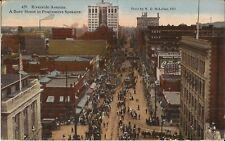 """Spokane, WASHINGTON - Riverside Ave. - """"Busy Street in Progressive Spokane"""" 1918"""