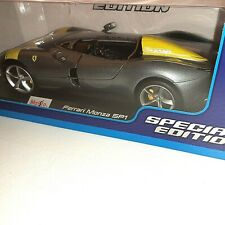 Maisto Ferrari Monza SP1 Silver Metallic with Yellow Stripes 1/18 Scale Replica
