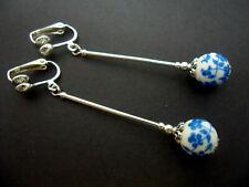 A PAIR OF  LONG DANGLY BLUE/WHITE PORCELAIN FLOWER BEAD CLIP ON EARRINGS. NEW.