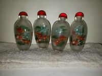 4 Chinese snuff bottles with reversed handpainted. Picture of Goldfishes and box