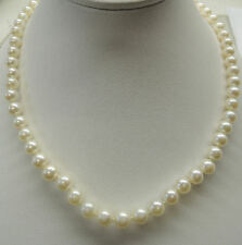 "Cultured Pearl Necklace 22"" long with 6 1/2mm pearls.14kt white clasp"