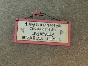 A hug is a perfect gift pink Plaque Sign