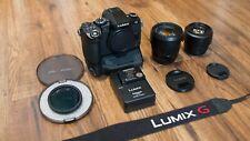 Panasonic LUMIX DMC-G85 w/ 12-60mm f3.5-5.6 Power O.I.S. & 25mm f1.7 + Extras.