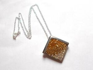 VINTAGE 1980'S AMBER / BROWN GLASS CRYSTAL SILVER TONE STAINLESS STEEL PENDANT