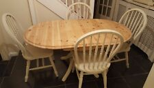 Solid pine oval table and four large kitchen chairs in Old Ochre Annie Sloan.